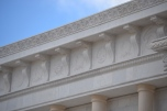 The 17 counties in Nevada and state and Nevada Supreme Court seals are carved in stone on the eaves.