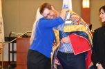 Presiding veterans' court Judge Adrianna Escobar and the Nevada state coordinator for the Quilt of Valor Foundation, Victoria Colburn Hall were there to wrap him in a beautiful Quilt of Valor.