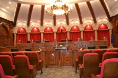The Supreme Court courtroom in the basement of Library of Congress in Washington, DC was the inspiration for the design.