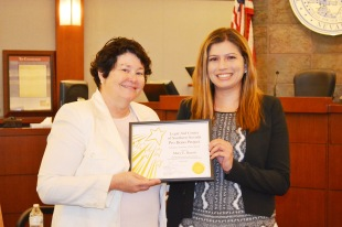 District Court Chief Judge Betsy Gonzalez with Mary Bacon the Legal Aid Center of Southern Nevada pro bono volunteer of the month for June.