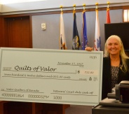 A check was presented at a recent Veteran' Court graduation ceremony to the Nevada state coordinator for the Quilt of Valor Foundation, Victoria Colburn Hall.