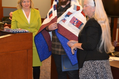 Quilts of Valor and Judge Linda Bell present Veterans Court graduates a Quilt of Valor a quilt to comfort them as they build their new lives.