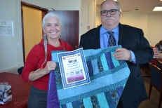 Victoria Colburn-Hall awards quilt to raffle winner.