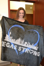 Raffle winner of Vegas Strong blanket designed by Minddie Lloyd.