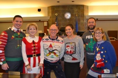 Judge Nancy Allf with the ugly sweater contest participants.