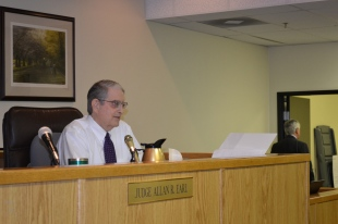 District Court Judge Allan R. Earl during construction defect sweeps.