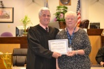 Jeanne Muchow CASA of the month with Judge Frank Sullivan who presides over the CASA program.