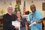 Bettina Debruyn CASA of the month with Judge Frank Sullivan who presides over the CASA program.