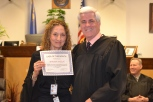 Roberta Ainslie CASA of the month with Judge Frank Sullivan who presides over the CASA program.
