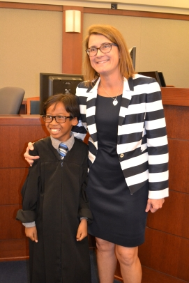 Judge Jennifer Togliatti takes photo with junior judge who nailed his stint on the bench. After his mock role he said he wants to be a judge.