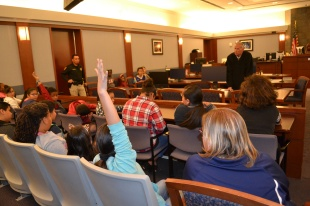 After fourth graders sat through his criminal calendar, Judge Doug Herndon took their questions.