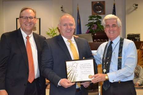 Judge Frank Sullivan and Judge Bryce Duckworth award attorney James Claflin Jr. the family law Legal Aid Center of Southern Nevada Pro Bono volunteer of the month award.