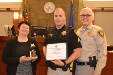 Chief Judge Elizabeth Gonzalez, Deputy Marshal of the Year Mark Vobis and Court Security Director Tom Newsome