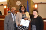 Court Services Manager Ed May, Employee of the Year Erica Page, Chief Judge Elizabeth Gonzalez