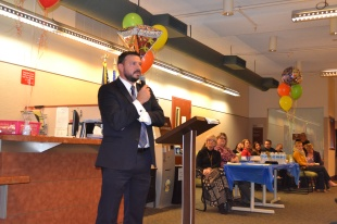 Deputy Public Defender John Piro offers speciality court graduates motivation to continue their success with the program.