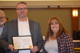 Judge Joanna Kishner read the accomplishments of Trevor J. Hatfield who was recognized the Legal Aid Center of Southern Nevada pro bono volunteer of the month.
