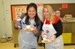Minddie Lloyd and Christine Erickson serve up desserts for students at Mt. View.