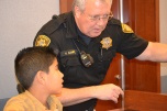 Marshal Bill Campbell teaches a young recruit the ropes of keeping a courtroom safe.