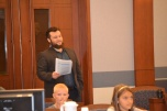 Mike Kamer with Project Real keeps an eye on student progress through the mock trial.