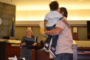 "A baby cries as Judge Carolyn Ellsworth begins the graduation ceremony for the March class of drug court graduates. The judge smiles and tells those gathered, ""It's great to have the babies here. It's great that they're here and come into the world drug-free."""