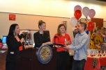 Judge Cristina Silva congratulates graduate.